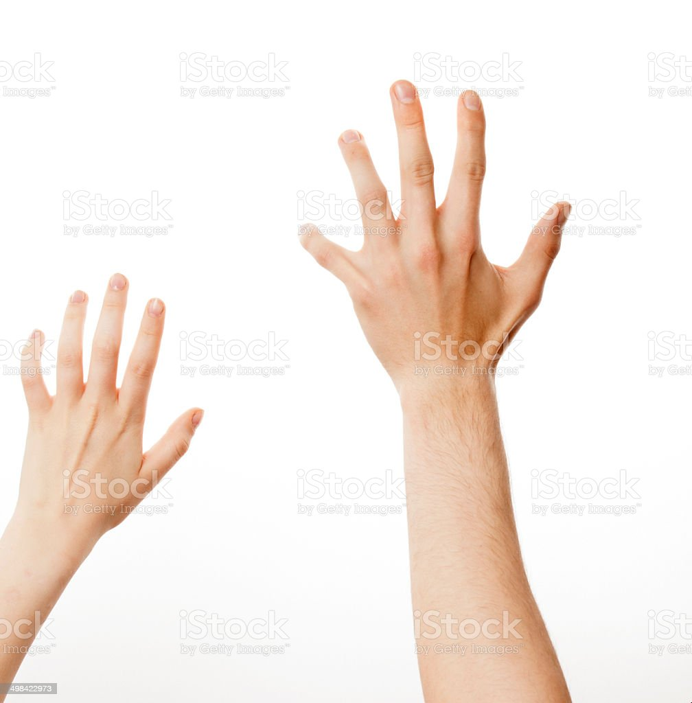 woman and man up hand reaching for something, isolated stock photo