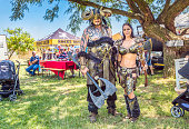 Man and woman vikings in their armor with a battle axe. Various kiosks, selling food, toys and viking gothic goods at the fair in Muldersdrift, north of Johannesburg, South Africa.