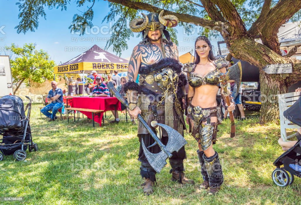 Woman and man vikings in armor at the fair in Johannesburg stock photo