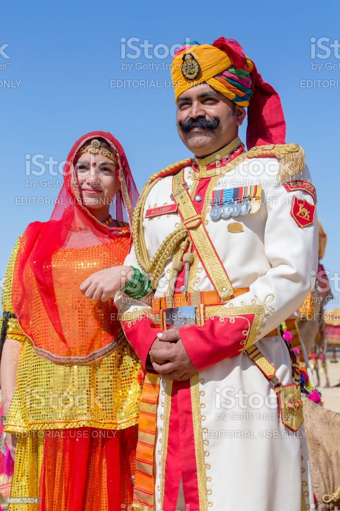 Woman and man wearing traditional Rajasthani dress participate in Mr. Desert contest as part of Desert Festival in Jaisalmer, Rajasthan, India stock photo