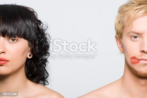 856575766istockphoto Woman and man with lipstick kiss 79122296