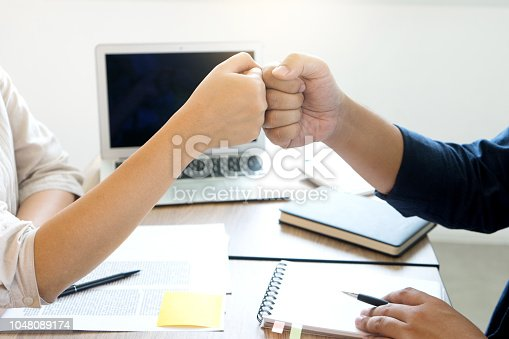 istock woman and man work for education or business on the table 1048089174