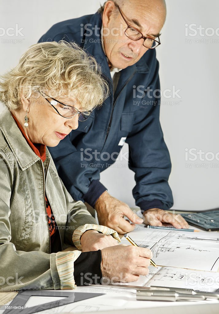 Woman and Man Working at Desk royalty-free stock photo