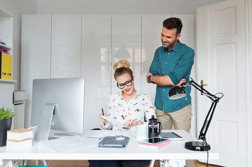 Woman And Man Working In An Office Stock Photo - Download Image Now