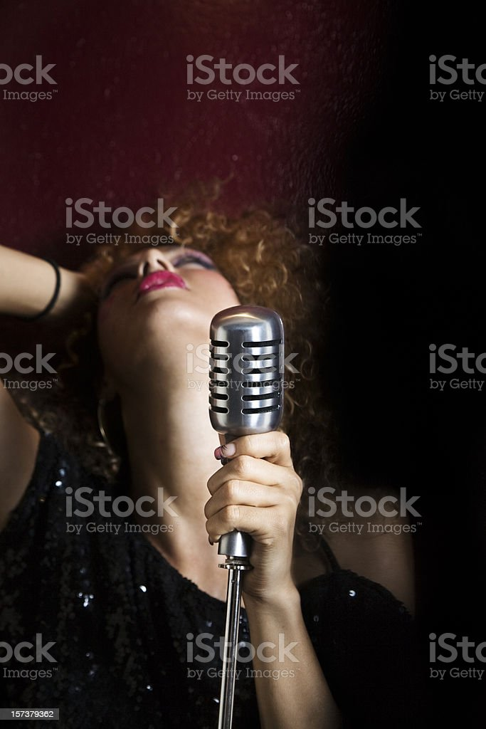 Woman and microphone royalty-free stock photo