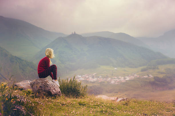 woman and mountain landscape stock photo