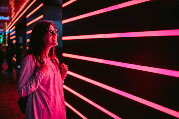Woman and neon light stock photo
