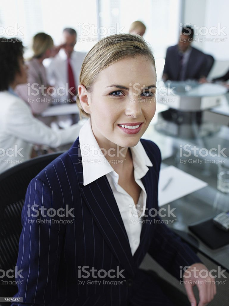 Woman and office colleagues in a boardroom meeting royalty-free stock photo