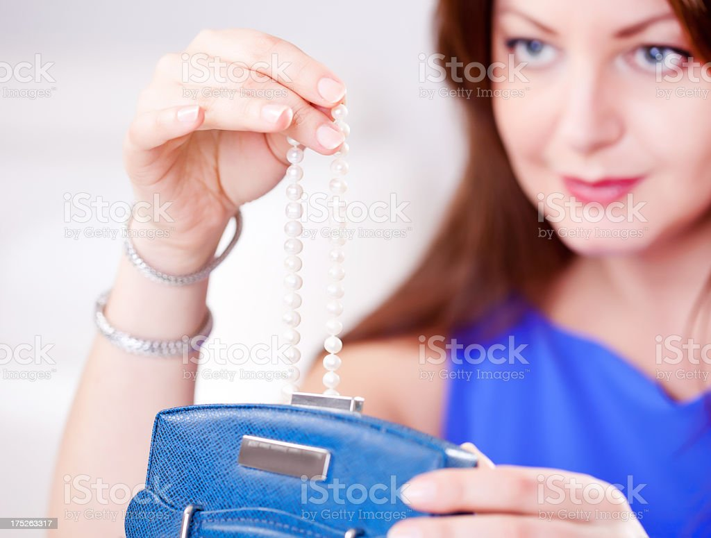 Woman and pearls royalty-free stock photo