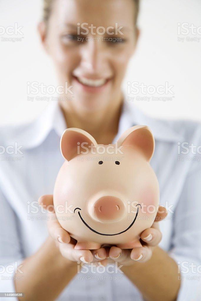woman and piggybank royalty-free stock photo