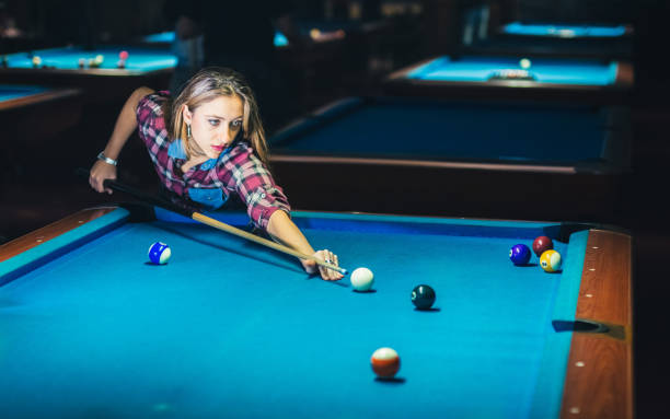 woman and plays billiard and have fun. - pool cue stock photos and pictures