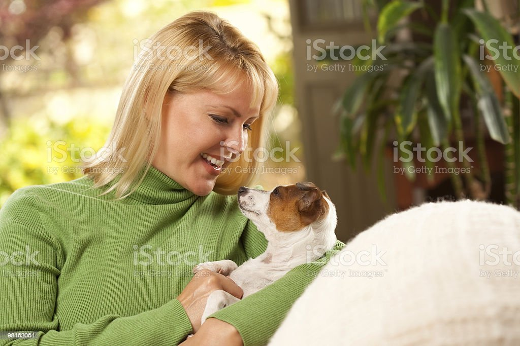 Woman and Puppy Enjoying Their Day on The Sofa royalty-free stock photo