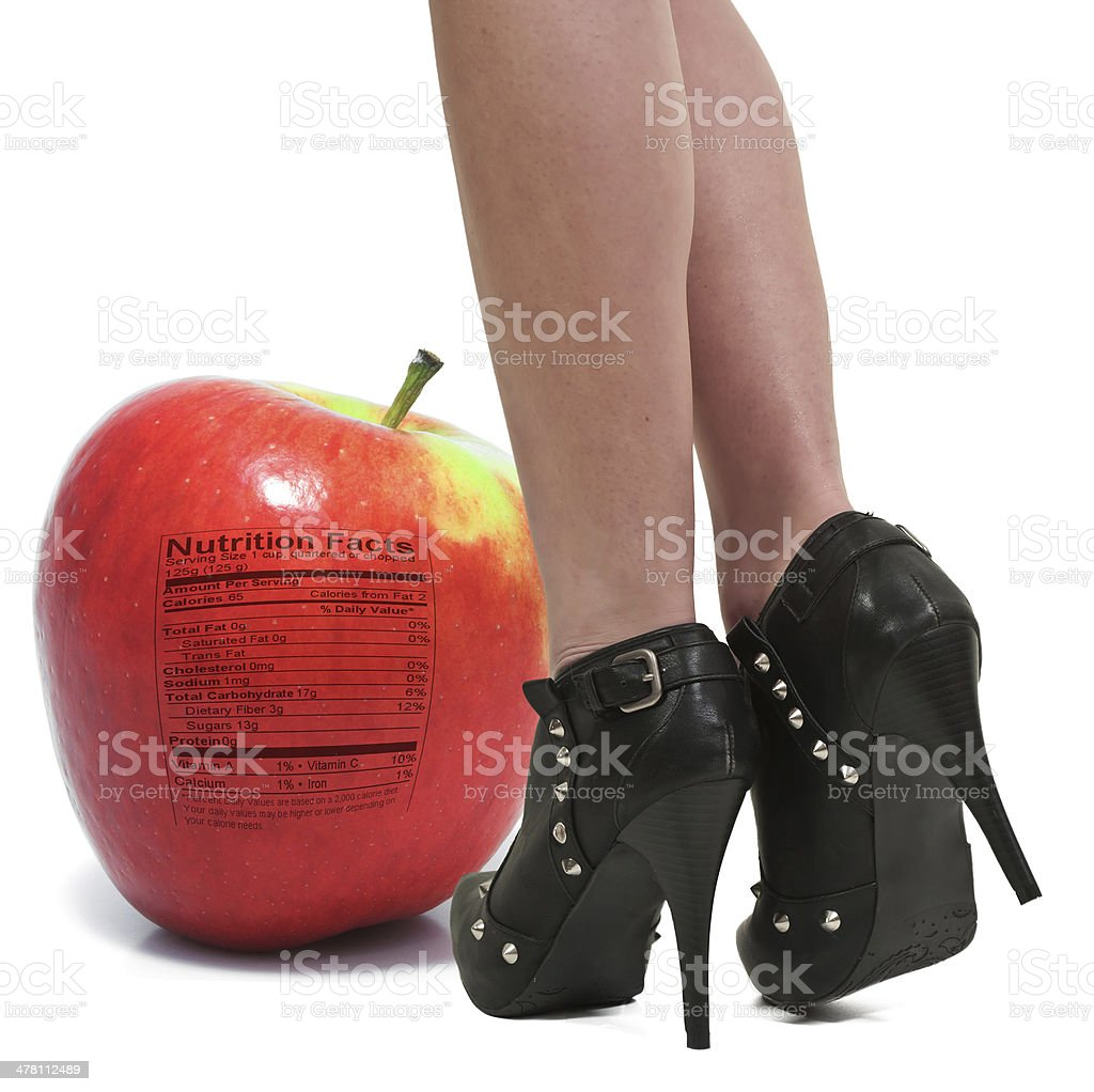 Woman and Red Delicious Apple with Nutrition Label stock photo