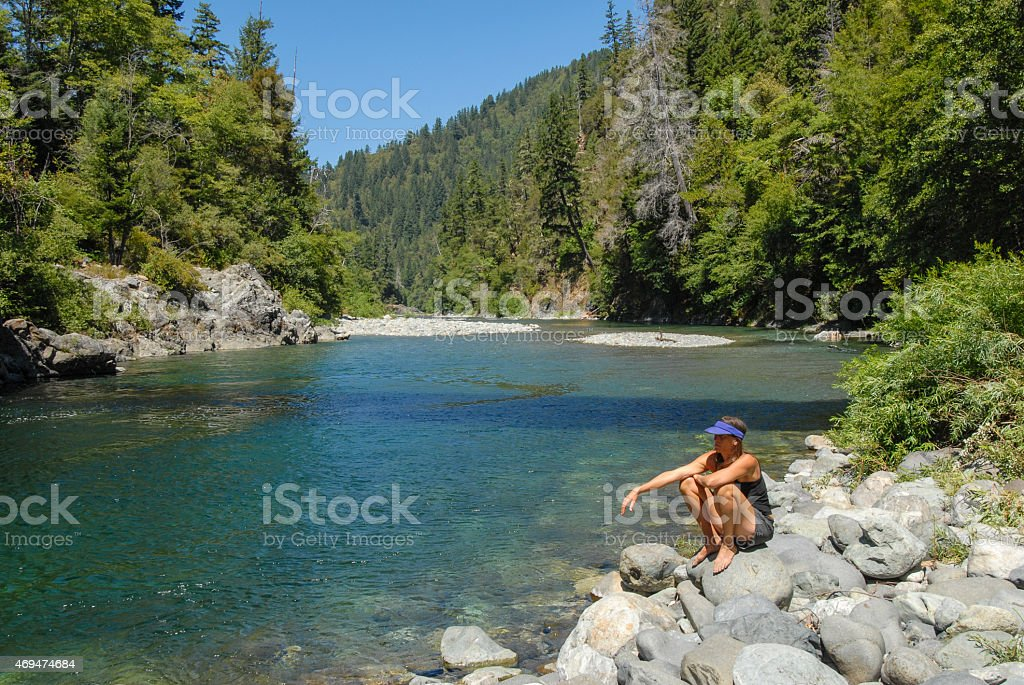Woman and river stock photo
