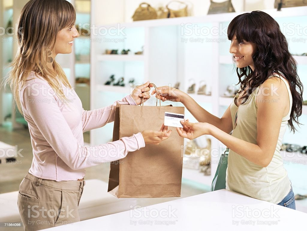 Woman and sales assistant stock photo