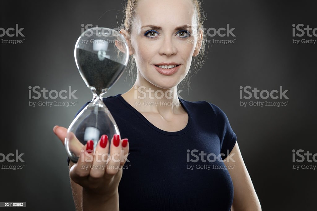 woman and sand timer stock photo