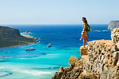 woman and scenic view at Balos bay on Crete