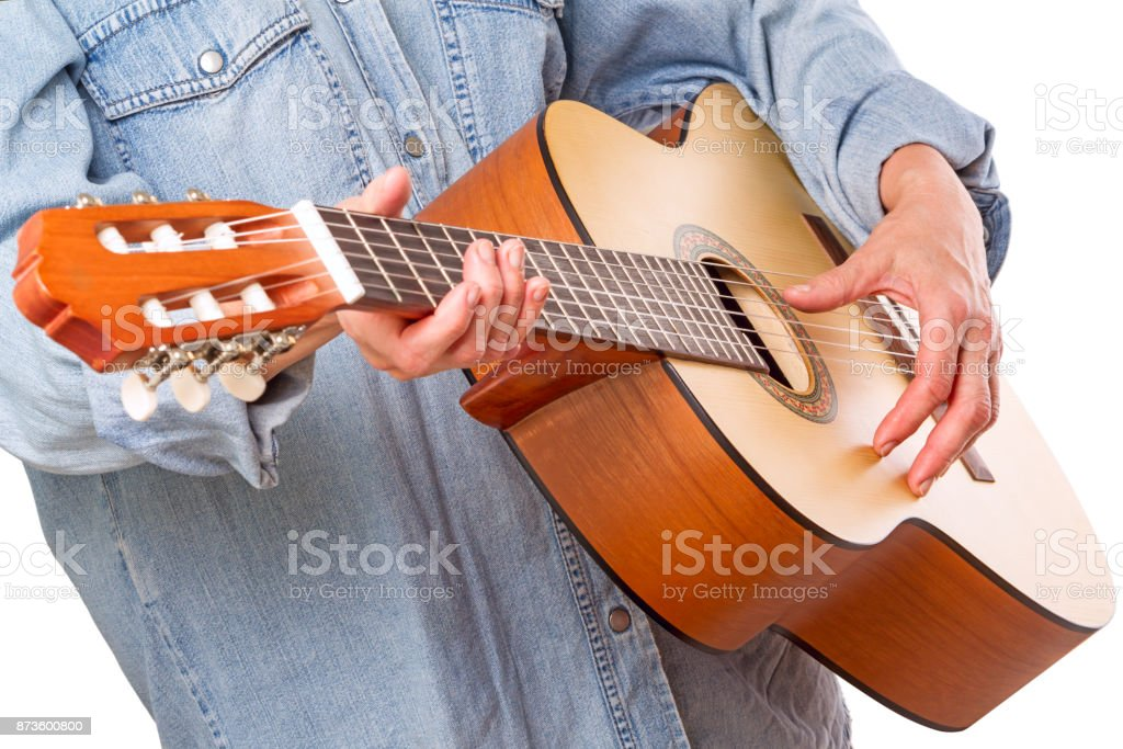 Woman and six-stringed guitar stock photo