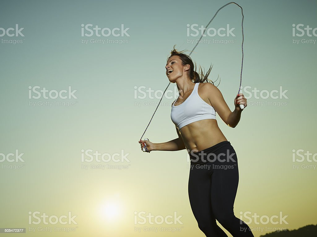 Woman and skipping rope stock photo
