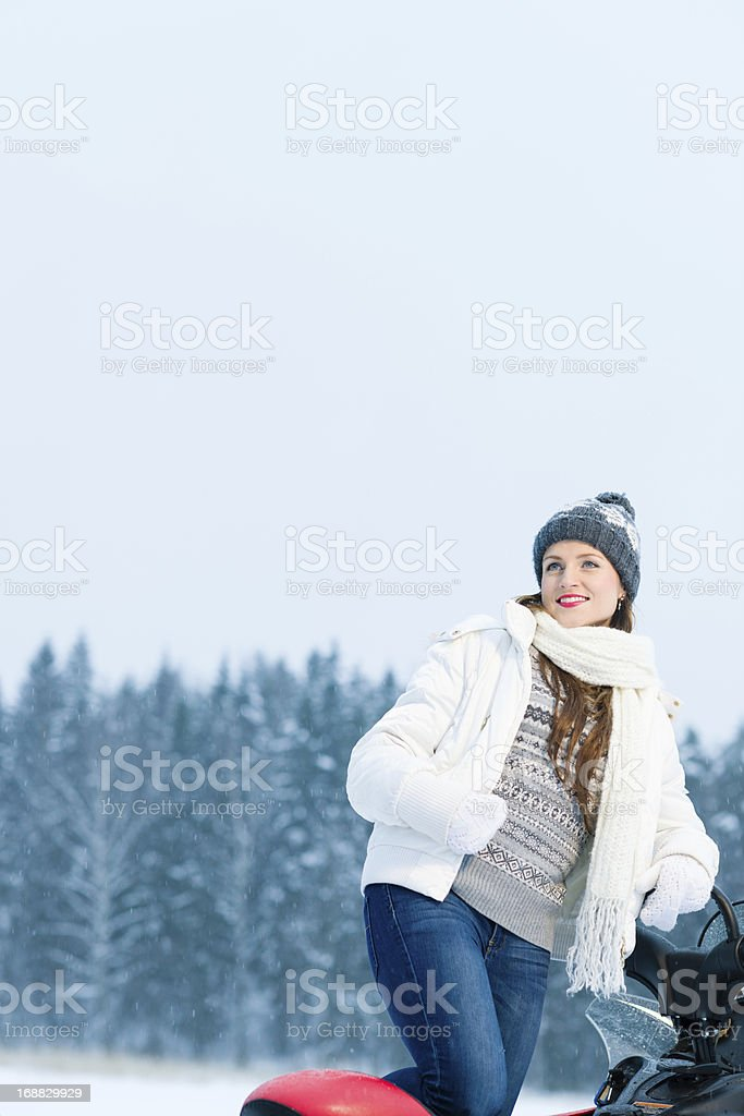 Woman and snowmobile royalty-free stock photo