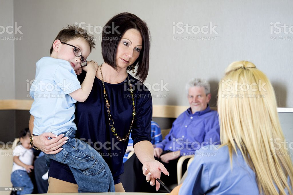 Woman and Son at a Doctor's Office royalty-free stock photo