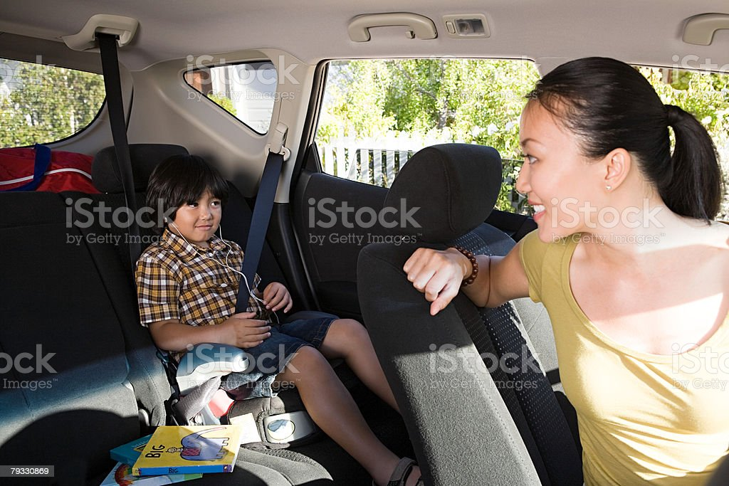 Woman and son in car 免版稅 stock photo