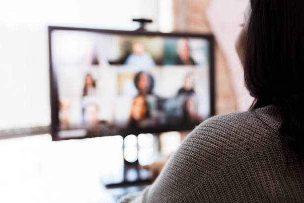 Woman and team meet via video conference stock photo