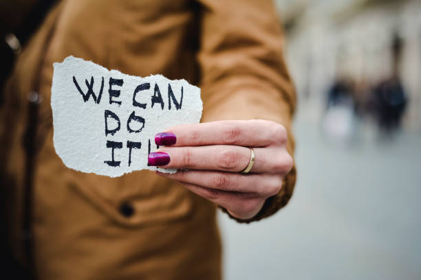 woman and text we can do it - womens day stock photos and pictures