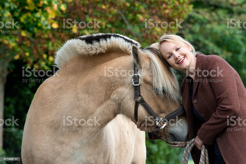 Woman and the love for her horse stock photo
