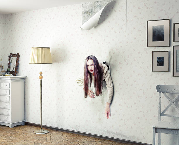 woman and the wall woman climbs through the wall into the room (photo and cg elemrnts compilation) trap stock pictures, royalty-free photos & images