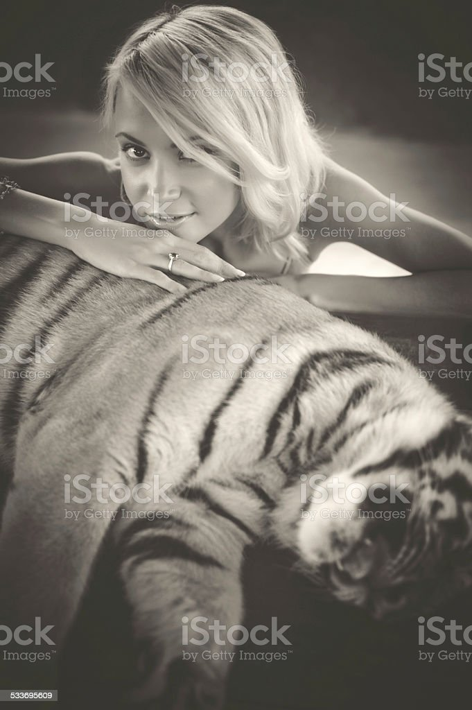 Woman and tiger stock photo