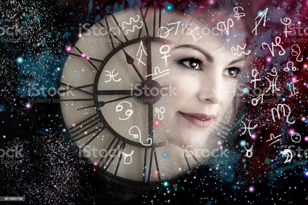 Woman and time, world of astrology stock photo