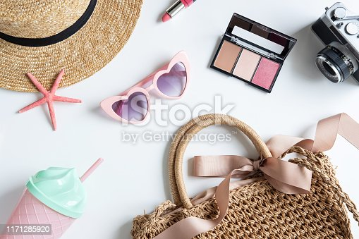 941183588 istock photo Woman and travel accessories with make up, cosmetics, brush and camera, Top view 1171285920