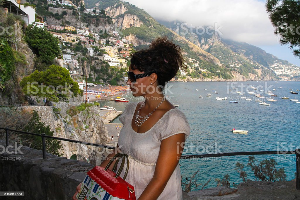 Woman and view of Positano stock photo