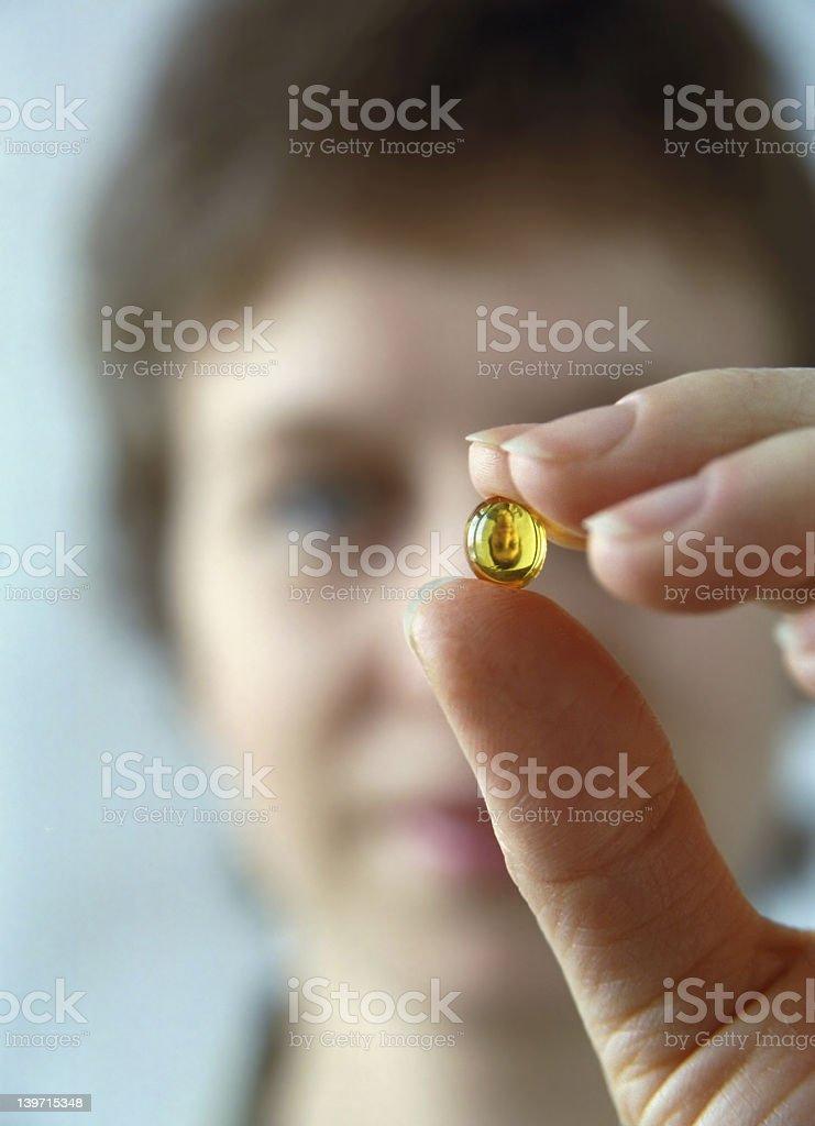 Woman and vitamin royalty-free stock photo