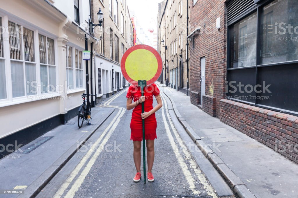 Woman and  warning sign stock photo