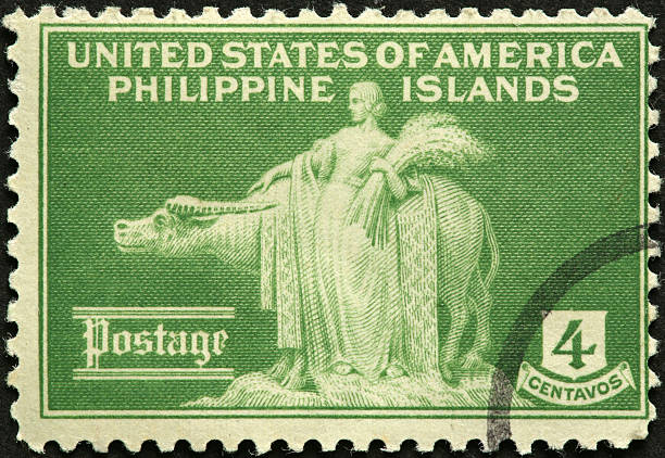 woman and water buffalo on an old Philippine stamp stock photo