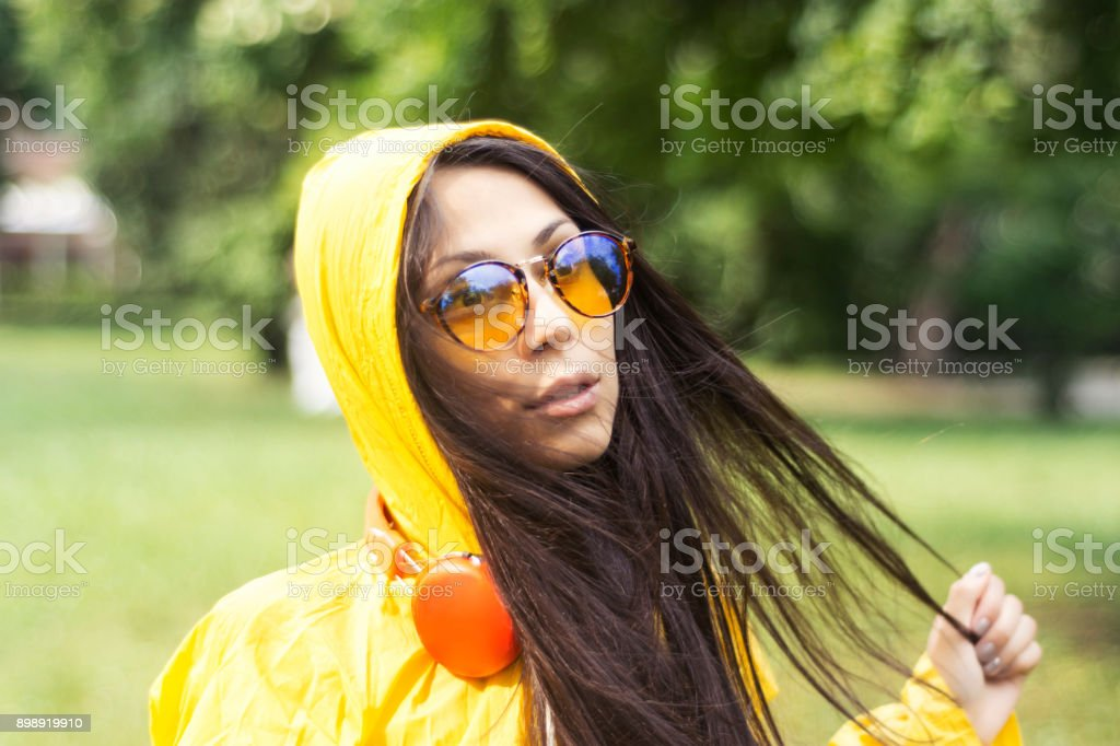Woman and yellow raincoat stock photo