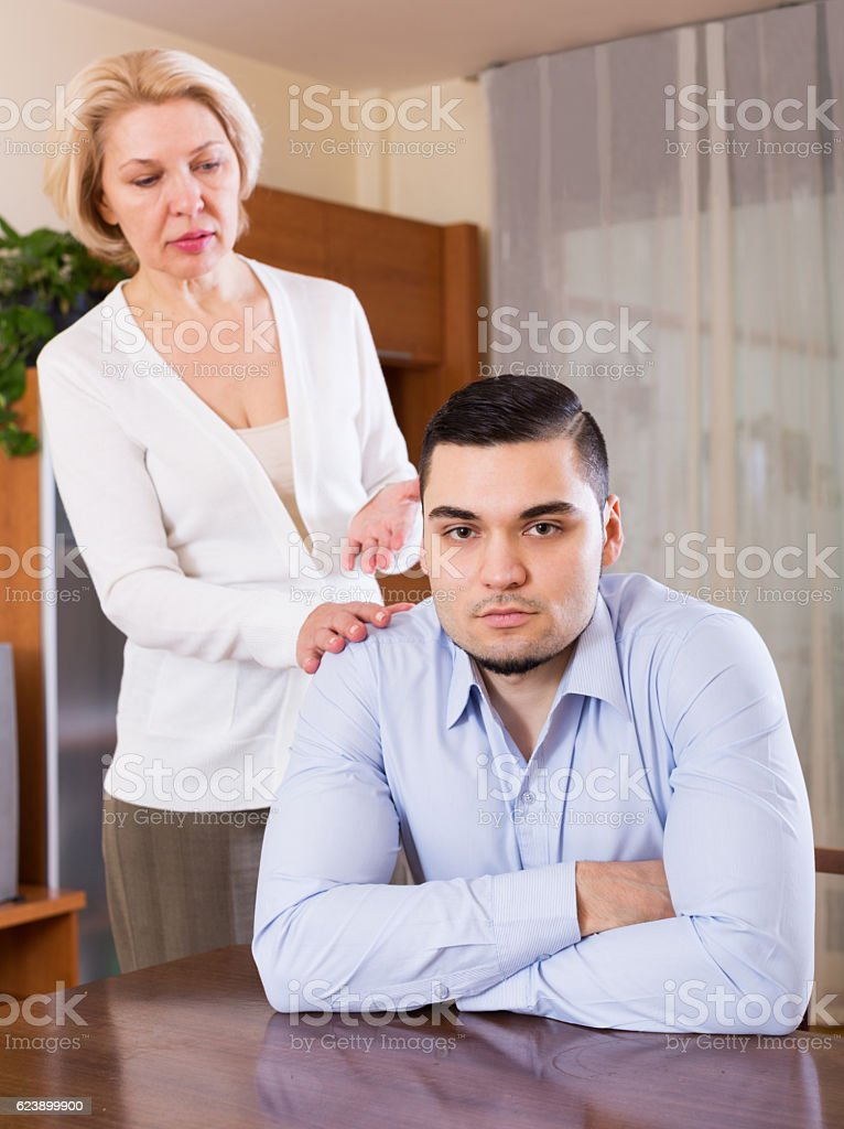 woman and young fiance signing marriage settlement stock photo