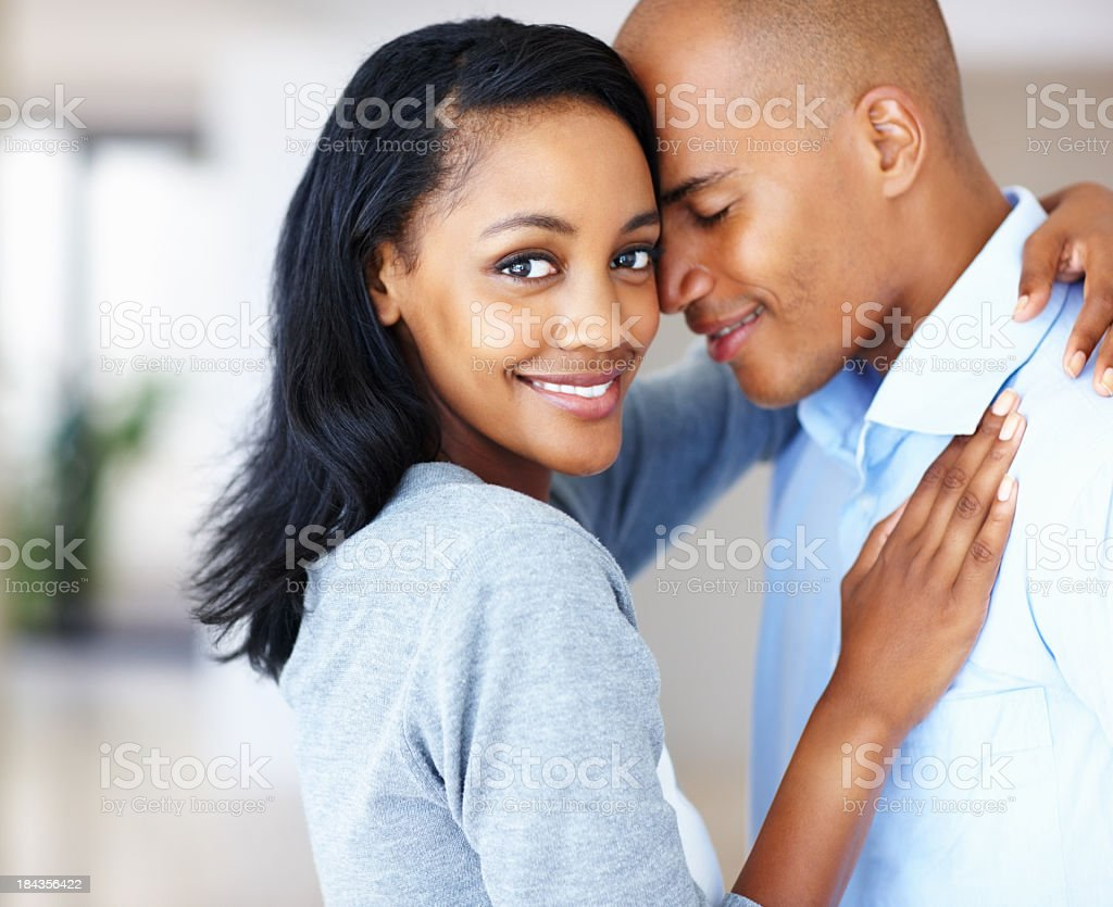 Woman and young man embracing stock photo