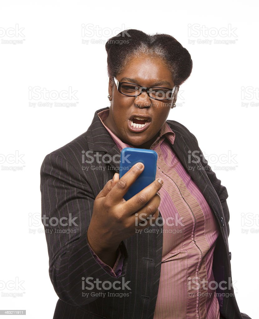 Woman angry at mobile phone stock photo