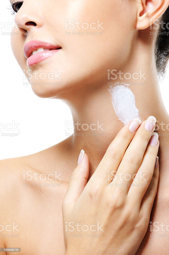 Woman   apply  cream on neck stock photo