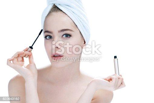 532331272 istock photo Woman applying black mascara 522643152
