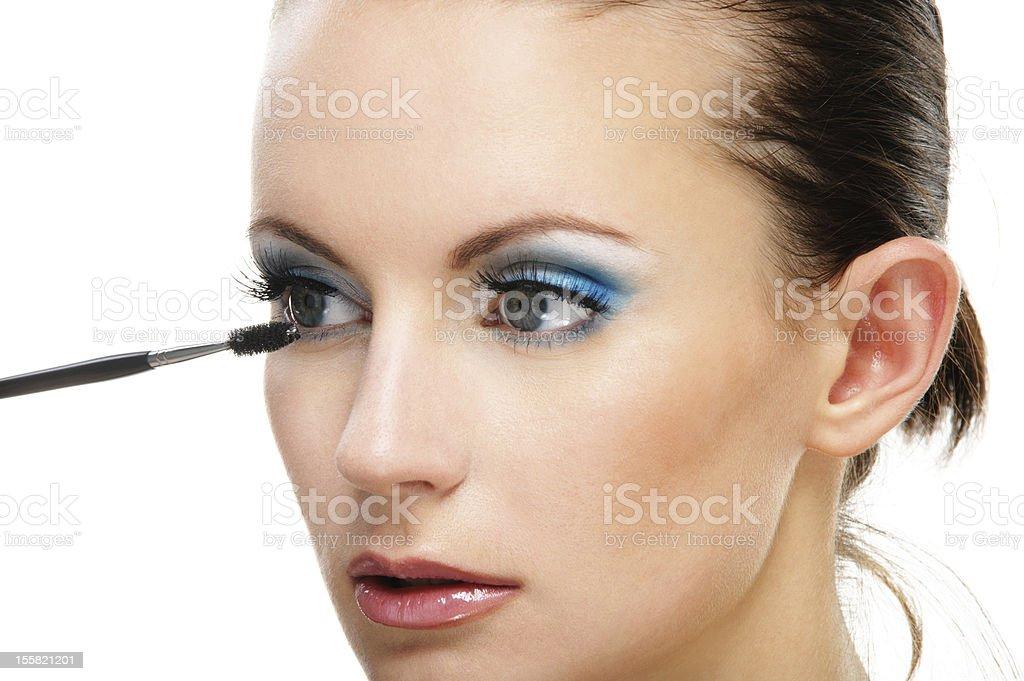 Woman applying blusher eyelid royalty-free stock photo