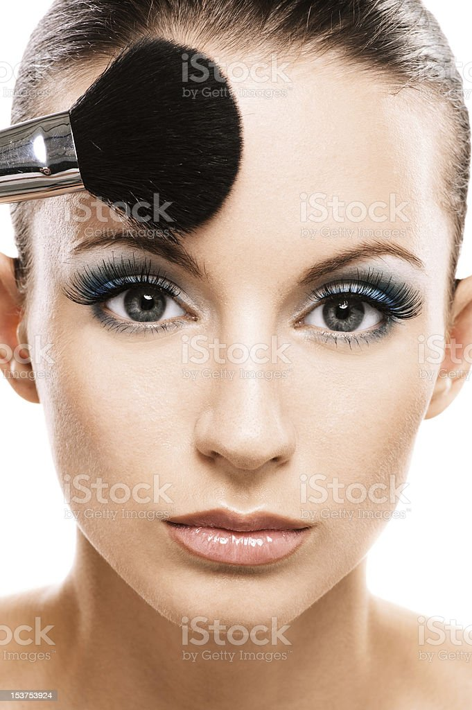 Woman applying blusher royalty-free stock photo