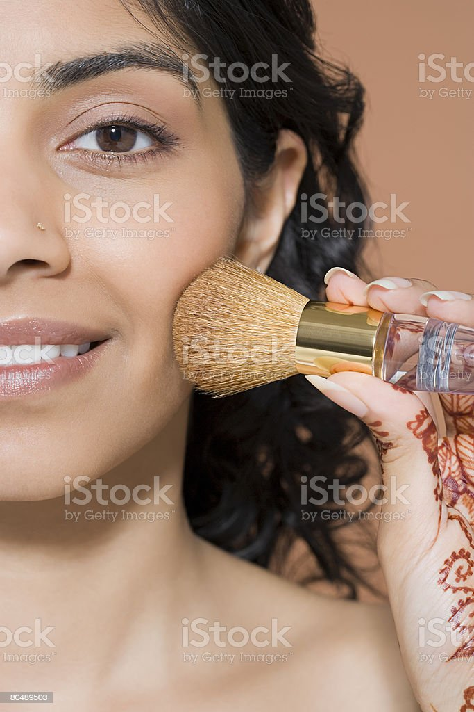 A woman applying blusher royalty-free 스톡 사진