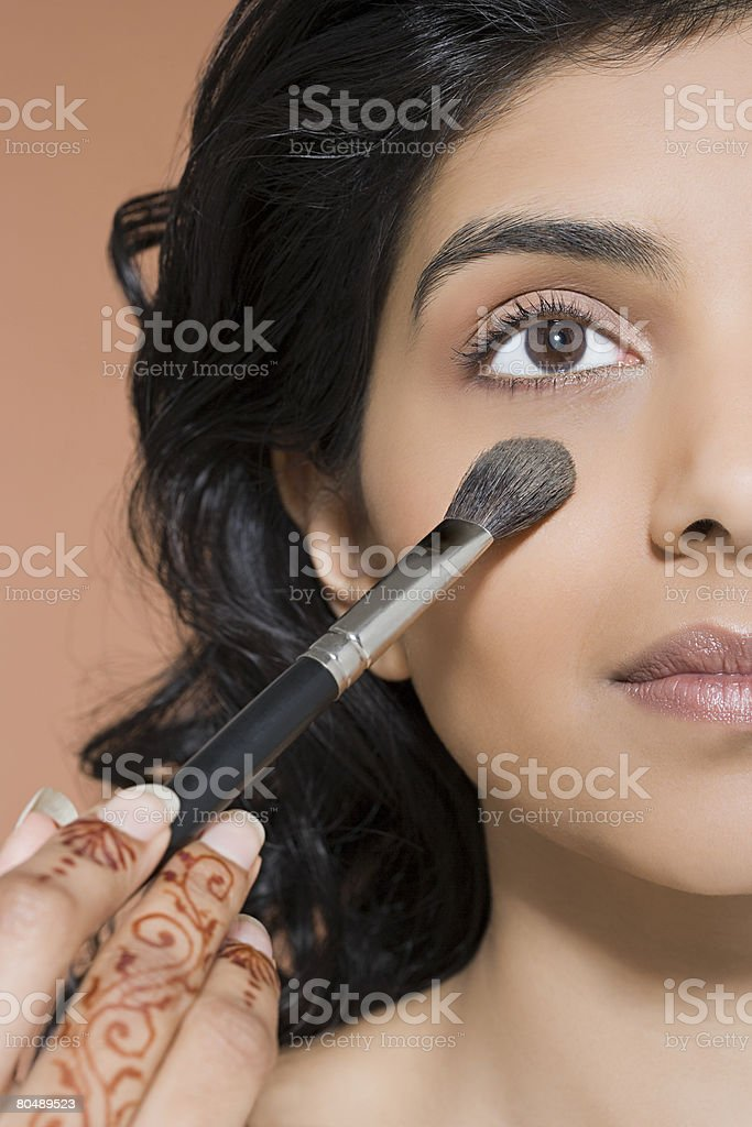 A woman applying blusher royalty-free stock photo