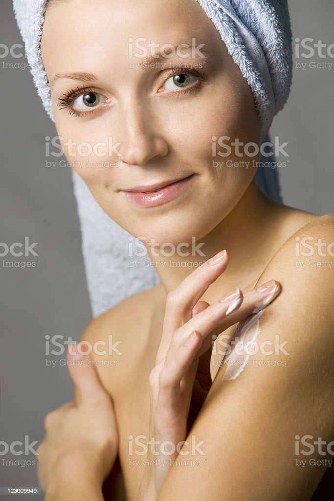 Woman Applying Body Lotion After Bathing royalty-free stock photo