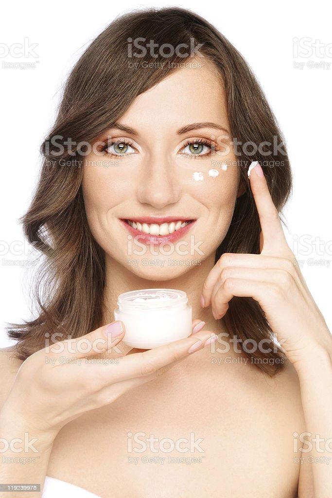 Woman applying cream royalty-free stock photo