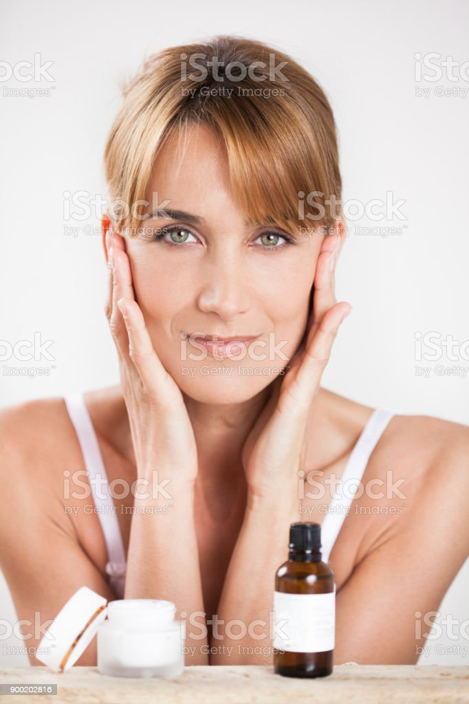 woman applying essential oils stock photo
